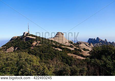 Telecommunication Antenna On A Mountain Peak . Multi Peaked Mountain Range Scenery