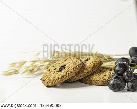 Oatmeal Raisin Cookies On White Background. Healthy Food Snack Concept.