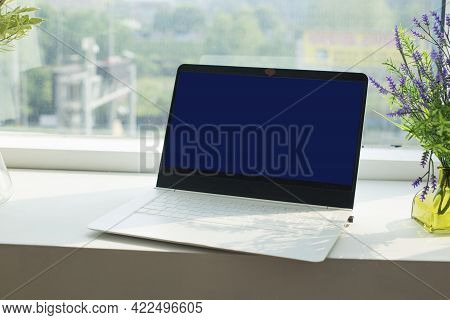 Close Up Laptop Computer On Top Of Office Table.