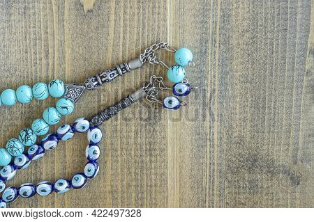 Two Blue Beads Sequenced, Short Rosary On Wooden Table. Tespih Tesbih, An Important Accessory For Tu