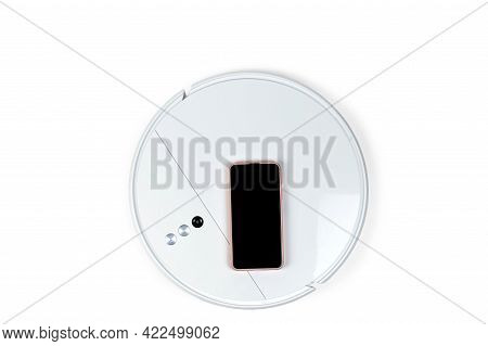 Robot Vacuum Cleaner, Isolated On A White Background. Modern White Robot Vacuum Cleaner And Smartpho