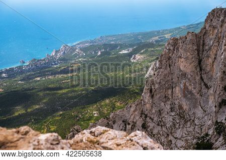 High Rocks Ai-petri Of Crimean Mountains. Black Sea Coast And Blue Sky With Clouds. Russia. Pine Mou