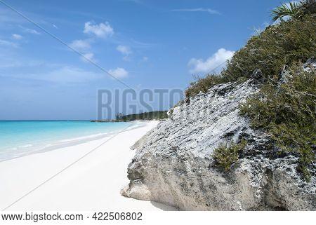 The Scenic View A Rocky Landscape And Sandy Beach On Half Moon Cay Uninhabited Island (bahamas).
