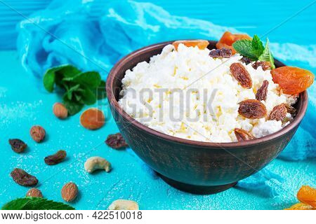 Healthy Breakfast Cottage Cheese With Raisins, Dried Apricots, Almond, Cashew And Mint