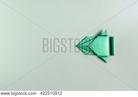 Concept Paper Car Of Green Color On A Green Background Of Kopi Space. Origami Bright Green Paper Car