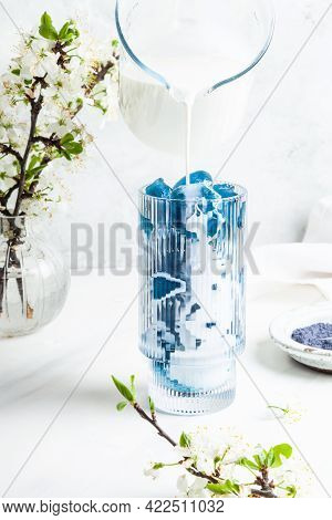 Blue Matcha Latte In A Glass On A White Background. Butterfly Pea Flower Powder. Superfood And Vegan