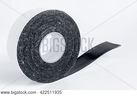 A Skein Of Black Double-sided Tape On A White Background Close-up Of The Place Under The Text