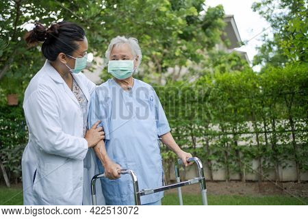 Doctor Help And Care Asian Senior Or Elderly Old Lady Woman Use Walker With Strong Health While Walk