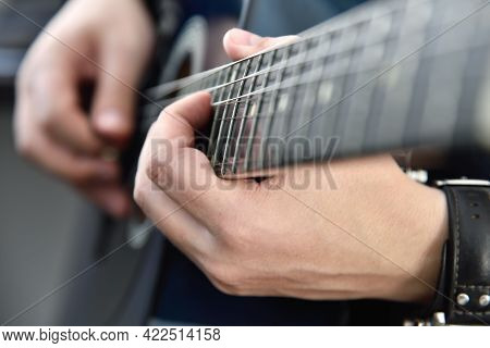 Guitarist Playing On Acoustic Guitar. Music And Art Concept. Close Up