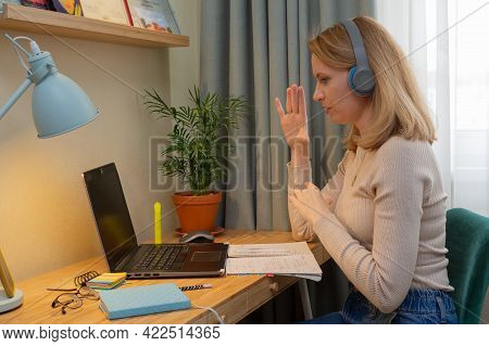 Woman In Headphones Online Teaches A Lecture For Students. Distance Learning Online Education And Wo