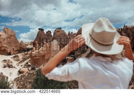 Beautiful Girl In A Hat Looks At The Landscape Of Cappadocia Geodesy Concept