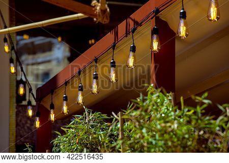 Awning In Backyard Gazebo With A Garland Of Strings Of Retro Edison Lamps Lighting Glow With Warm Li