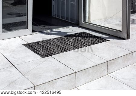 Threshold Made Of Light Gray Ceramic Tiles With Steps At The Entrance To The Store With A Foot Mat A