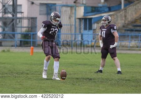 Odessa, Ukraine - May 30, 2021: American Football On The Grass. A Tough Duel, A Battle Between Odess