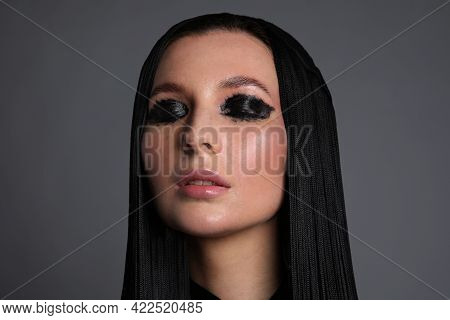 Side Portrait Of Young Woman With Black Eyeshadow Make-up And Wig. Isolated.