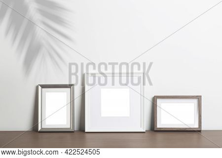 Mock Up Empty White Frame Background. Different Decorative Empty Frames For A Photo Or Painting In A