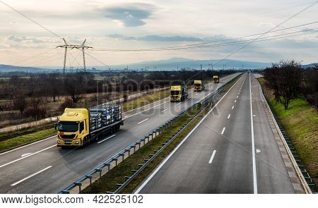 Portable Oxygen Tanks Transportation. Fleet Of Transportation Trucks Driving On Highway. Delivering
