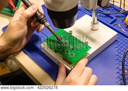 Soldering Process On A Green Pcb Close Up