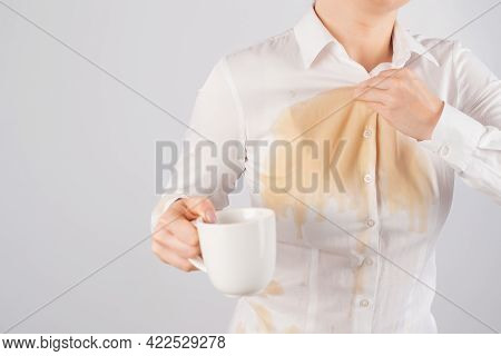 Clumsy Business Woman Spills A Cup Of Black Coffee On Her Blouse.