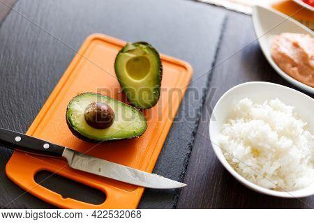 Cut In Half Avocado On The Cutting Board For Sushi