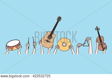 Musical Instruments And Creative Arts Concept. Human Hands Holding Musical Instruments Guitar Violin