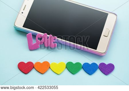 Lgbt Dating App Concept On Tablet And Mobile Phone. Gay Online Dating. Smartphone And Heart Love.