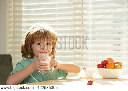 Kids Eating. Close Up Of Cute Little Boy Kid Drink Tasty Organic Milk With Vitamins Calcium From Gla