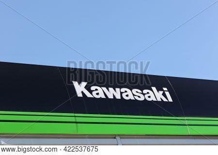 Lyon, France - July 3, 2016: Kawasaki Sign On A Wall. Kawasaki Is A Japanese Public Multinational Co