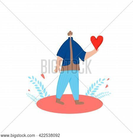 Kidness Concept. Young Man Holding A Heart In His Hand. Romantic Emotion. Teenage Boy Standing With