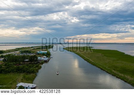 Aerial View Of The Mobile Bay Causeway At Sunset On The Alabama Gulf Coast