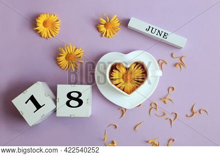 Calendar For June 18: The Name Of The Month Of June In English, Cubes With The Number 18, A Cup Of T