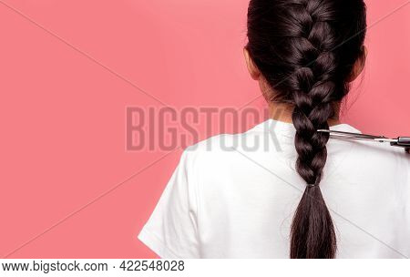 Back View Of Asian Woman With Braided Hairstyle Is Cutting With Scissors For Donate To Cancer Patien