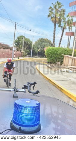 Group Of Professional Cyclists Training On Highway With Safety Escort Car, Security Light