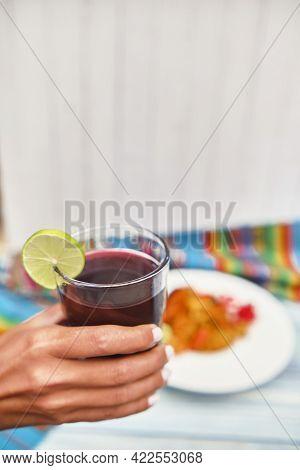 Peruvian Purple Corn Drink. Chicha Morada Purple Sweet Traditional Peruvian Corn Drink. ,woman Holdi