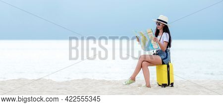 Happy Traveler And Tourism Young Women Travel Summer On The Beach. Asian People Siting Near Yellow