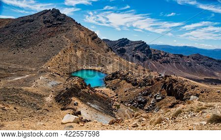 Looking Down From The Red Crater To One Of The Three Emerald Lakes On The Tongariro Alpine Crossing