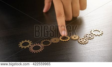 Business Solutions For Success And Strategy. Businessman Hands Connect The Gears With A Puzzle. Fulf