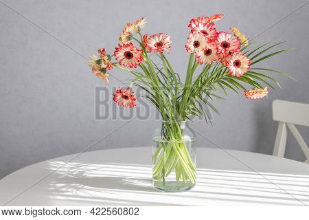 Bouquet Of Pink Gerberas, Flowers In A Vase On A Table In A Home Interior. Decorations, Home Decorat