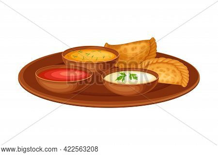 Fried Dumplings With Sauce As Indian Dish And Main Course Served On Plate And Garnished With Herbs C