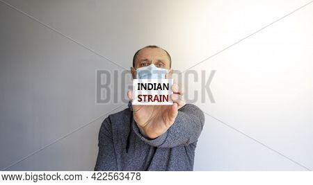 Covid-19 Indian Strain Symbol. White Card, Words 'indian Strain'. A Young Man In A Medical Mask. Sun