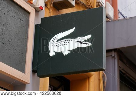 Bordeaux , Aquitaine France - 05 27 2021 : Lacoste Crocodile Logo And Text Sign On Facade Store Fron