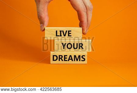 Live Your Dreams Symbol. Wooden Blocks With Words 'live Your Dreams'. Beautiful Orange Background, B