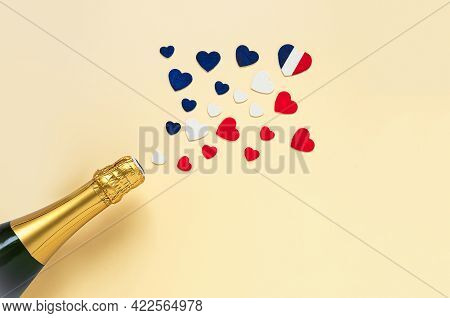 Hearts In The Colors Of The French Flag And French Champagne Bottle, Top View, Bastille Day And Fren