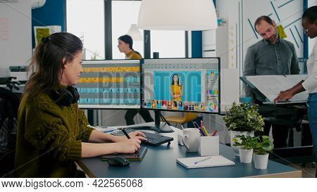 Retoucher Woman Working On Computer With Two Monitors And Stylus Pencil In Photo Editing Software Si