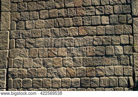 Cobblestone Road In The Park. Close Up Of Ancient Road With Smooth Stone Tiles.