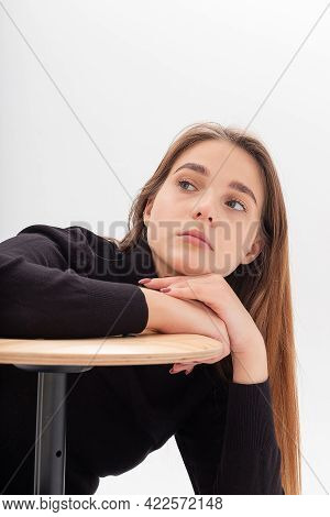 Portrait Of Young Attractive Caucasian Woman With Long Hair In Black Turtleneck, Blue Jeans Isolated