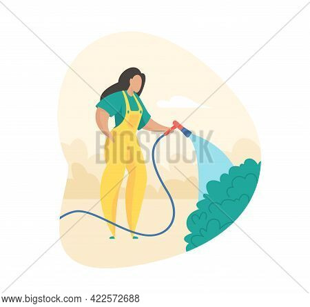 Gardener Is Watering Bushes. Caring For Park And Garden Vegetation. Woman In Uniform Carefully Water