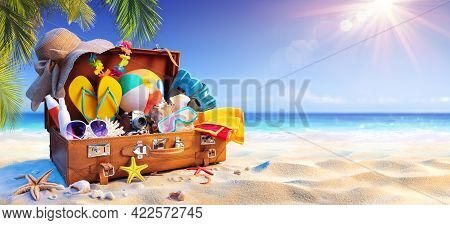 Suitcase On Sand In Tropical Beach With Sunny Sea And Palm Leaves