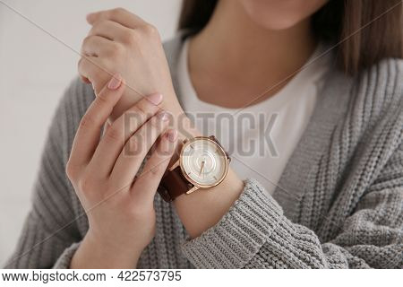 Woman With Luxury Wristwatch On Light Background, Closeup