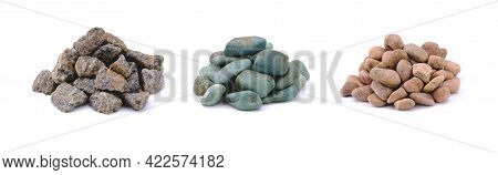 Three Heaps Of Colored Stones And Crushed Granite In The Form Of Rubble Isolated On A Clean White Ba